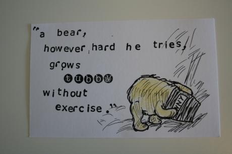 Winnie the Pooh eating honey