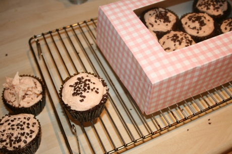 Chocolate Orange Cupcakes boxed up and cooling on a rack